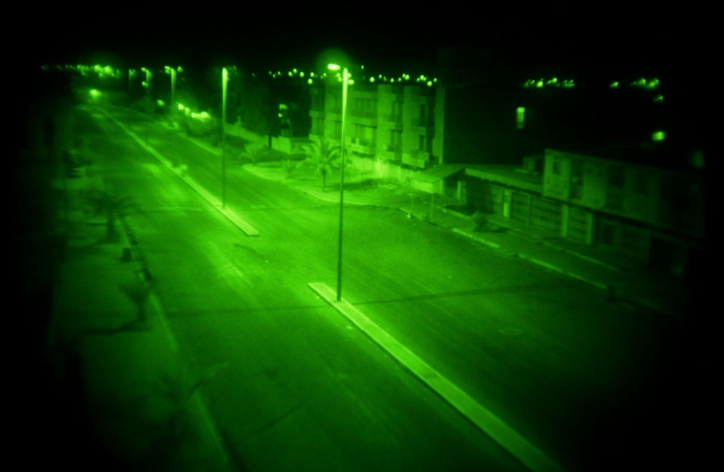 8/7/3 Tikrit, Iraq -  A three man scout team attached to the 1-22 infantry Brigade patrols the infamous RPG alley in the dead of night. Droped of in practically enemy territory the team makes their way to an elevated position to observe and possibly fire on any targets along the roadway. Photo by Benjamin Lowy/Corbis